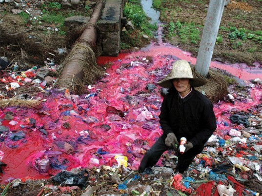 A river polluted with textile dye and other chemicals. Photo: Britannica