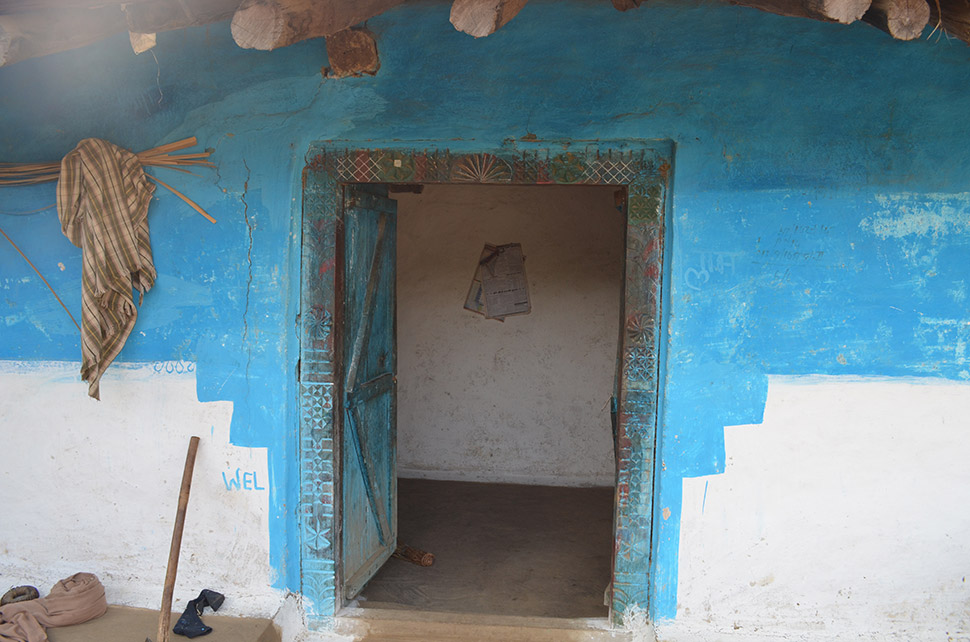 Bajari and Chaeti's family front door. Like many, they brought with them everything that could be moved, including, probably, the beams to their house, and the carved doorframe.