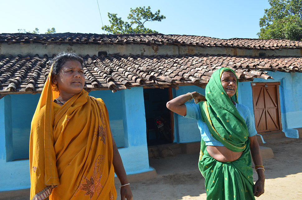 """Dussri Bai (right) and her daughter Susheela Bai were moved out in the 1970s. They and neighbors were resettled en masse from the namesake village of Kanha to the newly created village of Botalbehra, just outside the park. Their families once relied on hunting and gathering; many now work in tourism.  """"Even girls can do everything now,"""" said Dussri. """"They can leave and go to the city if they want!"""""""