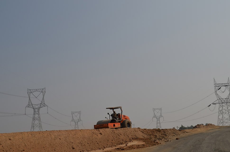 With population and economy booming, development is closing in on the park. Here, not far from the border, National Highway 30 is being radically widened, and giant power lines have sprouted.
