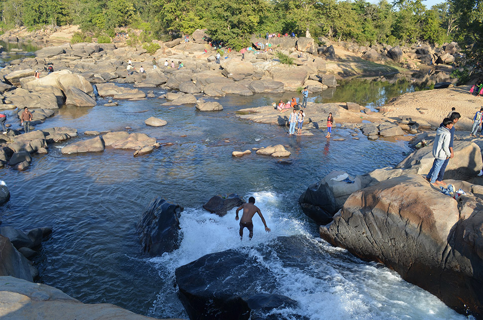Celebrants bathe in the river. By late afternoon, people are starting to go back to civilization, until the next year.