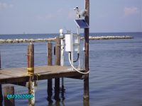 A NOAA water level monitoring station with an acoustic sensor on Dauphin Island, Alabama. Such tide gauges along the U.S. coast give scientists a baseline of sea level changes dating at least to the 19th century. Photo: NOAA/courtesy Morgan McHugh
