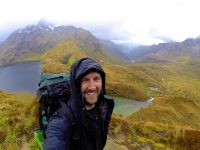 MS in Sustainability Management alum Alan Burchell, along the The Routeburn Track in the South Island of New Zealand.
