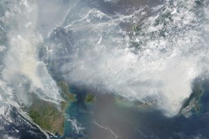Heavy smoke blanketed Sumatra and Borneo in September and October 2015, as observed by NASA's Terra satellite. (NASA image by Jeff Schmaltz, LANCE/EOSDIS Rapid Response.)