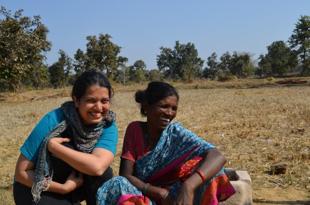 "Project leader Amrita Neelakantan shares a joke with Jaani Bai, whose family moved to the edge of this rice paddy three years ago. They have enough to eat, but when asked why they moved here, the answer is concise: ""The government told us to."""