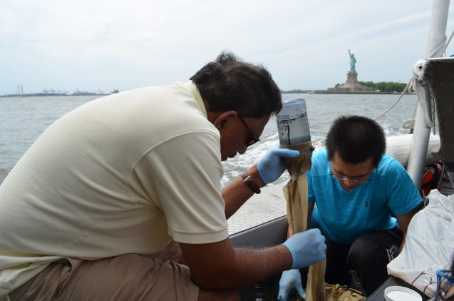 Aboard a vessel run by the environmental group Riverkeeper, oceanographer Joaquim Goes of Lamont-Doherty Earth Observatory (left) and PhD. student Ye Li filter water from New York harbor. They were on a mission to study the prevalence of plastic microbeads. (Photos: Kevin Krajick, unless otherwise credited.)