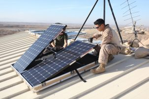Marines installing solar panels in Afghanistan.