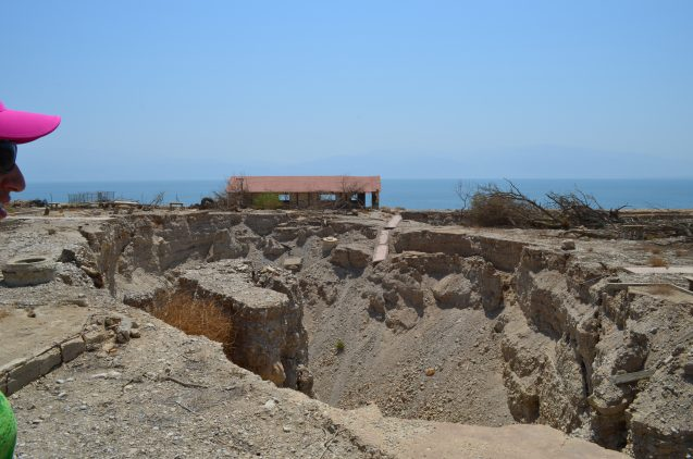 One result of dropping sea level: land along the shoreline is collapsing. Here, a sinkhole swallows the remains of a onetime Israeli beach resort.