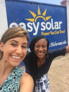 Anika Bahra and Nthabiseng Mosia in front of Easy Solar's first public wall painting advertisements in Freetown, Sierra Leone.
