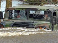 U.S. Army personnel drive through flood waters in Fort Ransom, ND. Photo: US Army