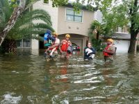 Soldiers help a family evacuate their flooded home in Houston, Texas.