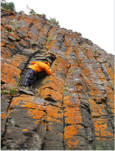 A researcher climbs a deposit left by massive volcanism in what is now Siberia 252 million years ago. The eruptions may have led to catastrophic environmental changes, says a new study. (Courtesy Linda Elkins-Tanton)