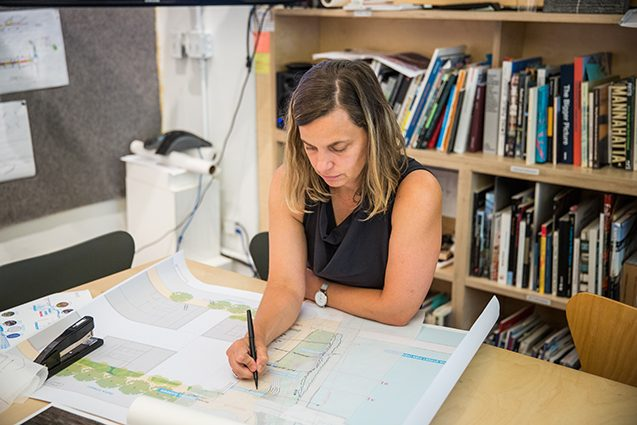 kate orff at a desk
