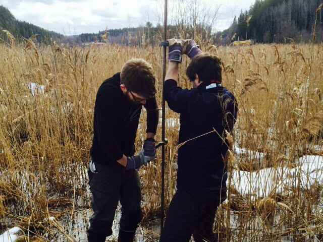 James Lea (left) and Francesco Muschitiello drill into the ground to sample the sedimentary deposits of an ancient glacial lake in Sweden. The layered deposits, called varves, document the ice sheet's response to changing atmospheric conditions. Credit: Francesco Muschitiello