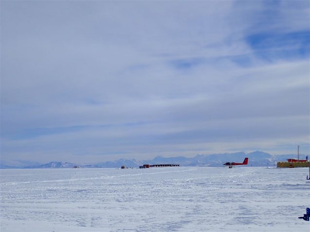 The landscape seems endless with ice shelf merging into white cloudy skies. The airplanes on the ice are close to the only relief.