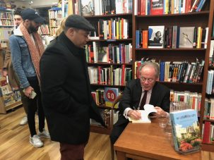 Steve Cohen signing books