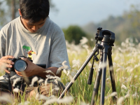 Photo of Paro Natung with a camera in the field