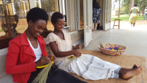 Young women learn traditional basket weaving