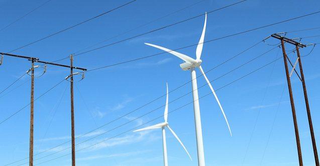 wind turbine behind power lines, clean energy