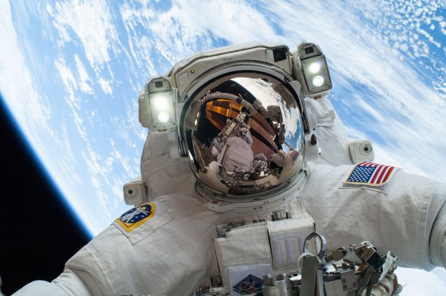 astronaut with earth behind