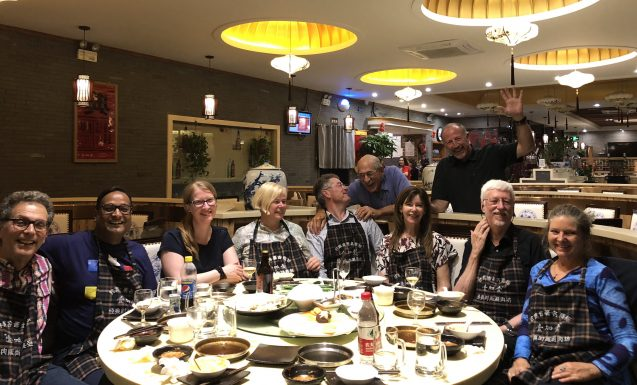 IPCC authors at dinner in a hotpot restaurant.