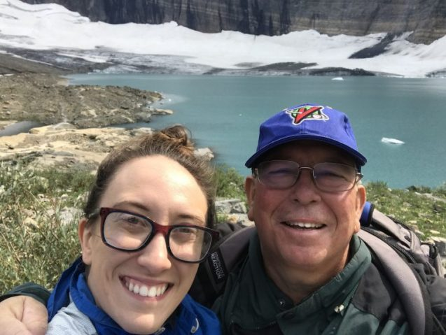 two people in front of glacier at glacier national park