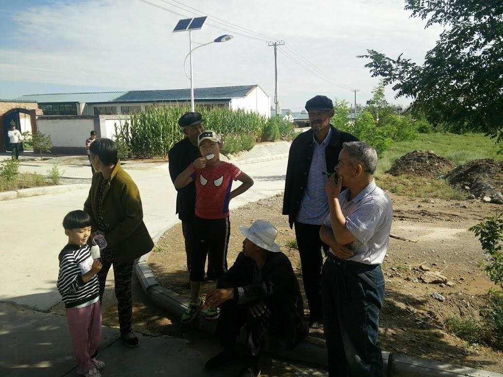 Village people gather on street corner