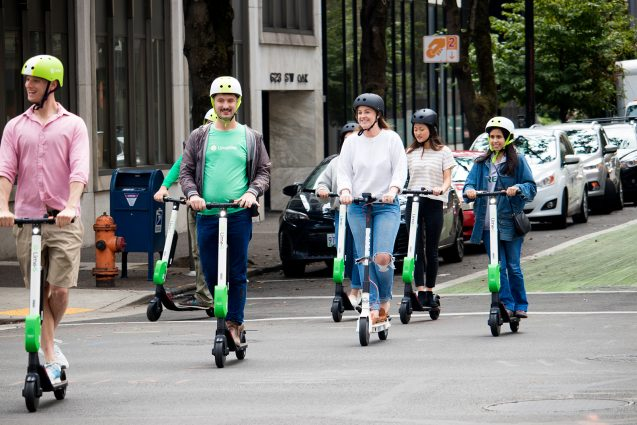 E-scooter riders take to the streets of Portland, Oregon. Photo by Sarah Petersen