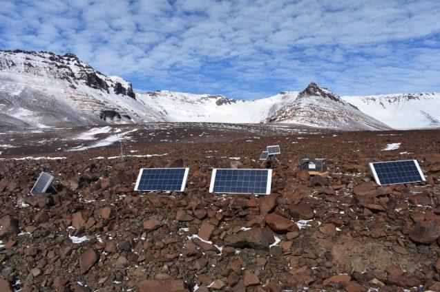 solar panels among barren rocks and hills