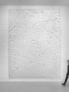 white artwork on wall