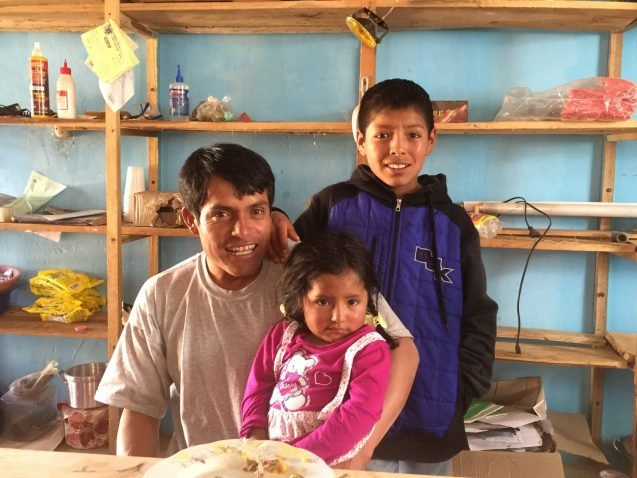 A village official and his children in Copa, Peru