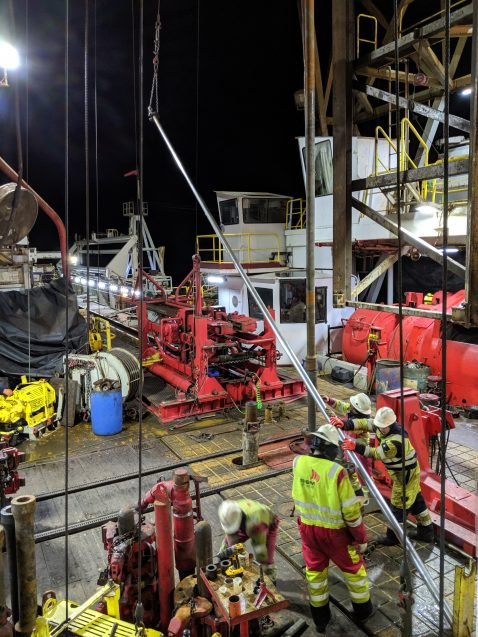 floormen and drillers work on ship