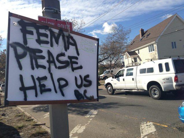 sign says 'fema please help us'