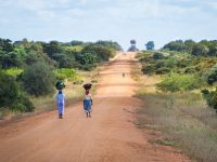 african women walking along road