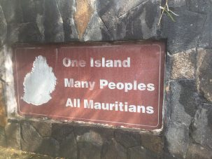 """sign says """"one island, many peoples, all Mauritians"""""""