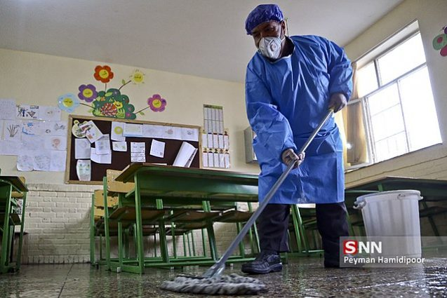 A worker disinfects a school in Bojnord, Iran