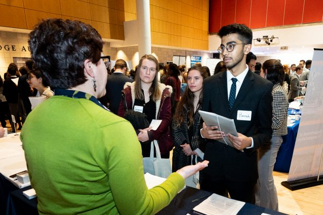recruiter speaks to students at career fair