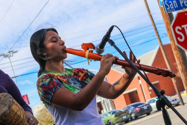 ceiba playing flute