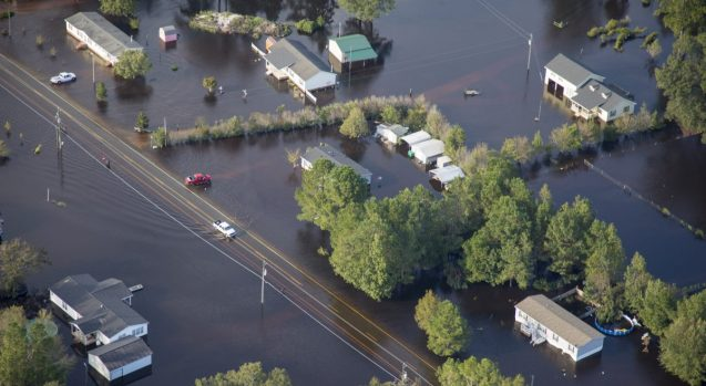 Buildings surrounded by water flowing out of North Carolina's Cape Fear River in the aftermath of Hurricane Florence. (Photo: Staff Sgt. Mary Junell/U.S. Army)