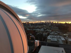 dome and city skyline at sunset