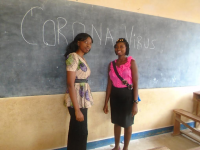 women in front of chalk board