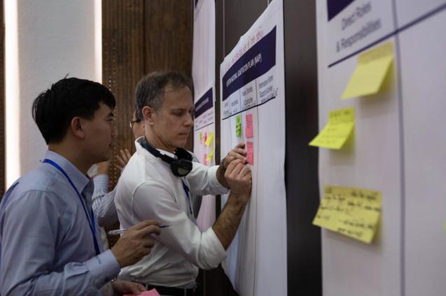 john furlow at a workshop in vietnam