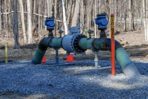 A natural gas pipeline rises out of the ground in Saratoga Springs, NY