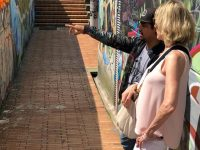 Beth Fisher-Yoshida admires a mural.