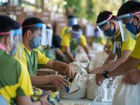 Workers pack up emergency response provisions in the Philippines.