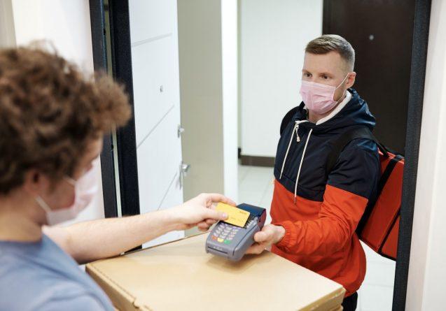business transaction while wearing masks