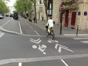 bicyclist rides in bike lane