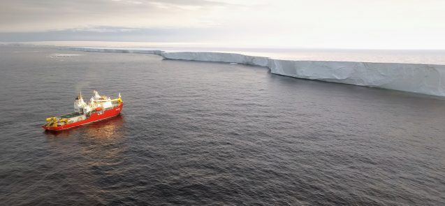 The South Korean research vessel Araon in front of West Antarctica's Getz Ice Shelf, viewed from a helicopter after researchers deployed on-ice instruments during summer 2018. (Photo courtesy of Pierre Dutrieux)