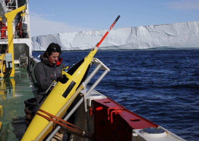 Pierre Dutrieux preparing a Seaglider for deployment in front of the Dotson Ice Shelf, West Antarctica, during a summer 2018 research expedition. (Photo courtesy of Pierre Dutrieux)