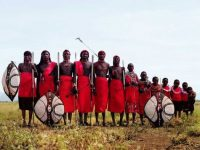 Members of the Maasai tribe dressed in traditional clothes posing for an advertisement